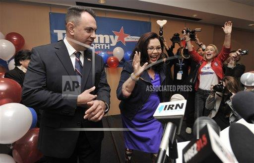 Celebrating 2012 win for Congress.  Credit:  AP Photo by Paul Beaty